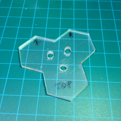Holes drilled in tri-hex base.
